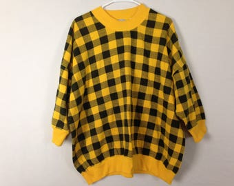 Yellow and black pattern sweater size L