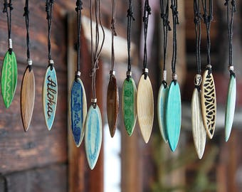 Wooden handmade surfboard pendant/necklace.