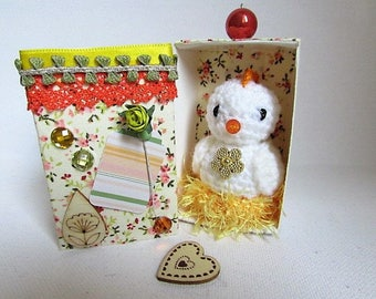 This Easter! cute white chicken in crochet in her nest with her box