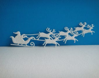 Cut Santa Claus and his reindeer in sheet of white foam for creation