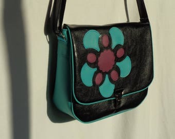 Black PU leather and turquoise blue appliqué on the flap Messenger bag.