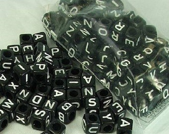 100 cubes are black with white letters 7 mm