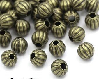30 6 mm bronze pumpkin beads