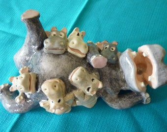 Hippos family: ceramic figurine.