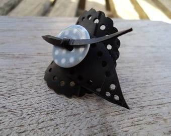 Round ring made with recycled tractor inner leaf with grey button with white polka dots