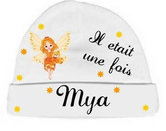 White baby hat it was once personalized with name
