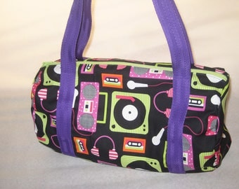 Bag of sports/dance music themed printed cotton