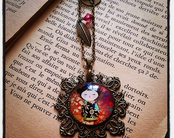 """Asian Doll"" cabochon pendant necklace with charms"