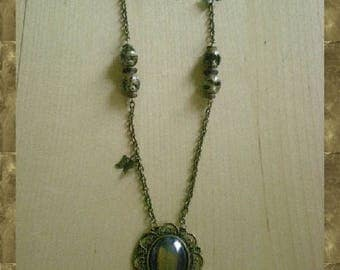 Print and black cabochon necklace