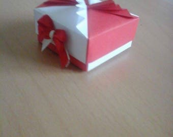 Box has light red and white origami