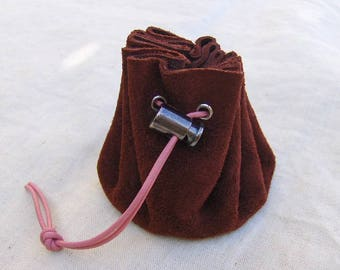 Coin purse is plum suede