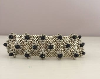 woven i black and silver beaded bracelet