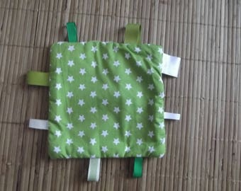 Green label with polka dots baby blanket.