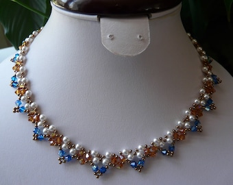 NECKLACE in PEARLY beads and Crystal SWAROVSKI CAPRI and Topaz
