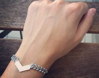 Ethnic bracelet with silver chevron and pale blue spike chain charm