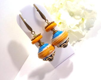 Ethnic earrings, Pearl are hand painted cardboard, predominantly turquoise and mustard, elegant bronze