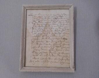 Ancient manuscript and framed under glass