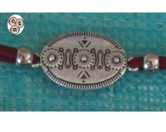 Textile bracelet with silver medallion and leather lace