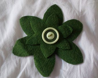 made with two felt flowers and a button pin