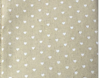 Hemp white heart on a beige background fabric