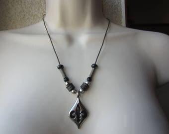 Necklace black and silver with Fleur de lis motif pendant