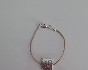 beige bracelet with silver square connector