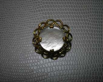 Gold metal and mother of Pearl button genuine