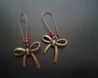 bronze earrings, bow and Pearl