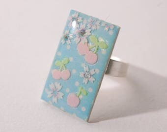 Ring cabochon pink cherries, cherry blossoms, blue dots