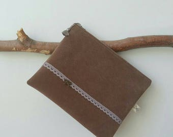 Small flat pouch in nubuck Brown.