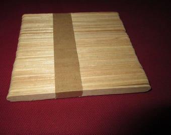 set of nine wood sticks