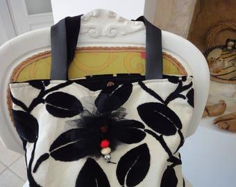 large bag and its black velvet flowers