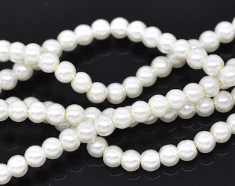 Wholesale lot of 500 white glass pearl beads, 6mm