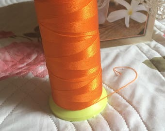 Yarn or light orange macrame cord. 0.5 mm.