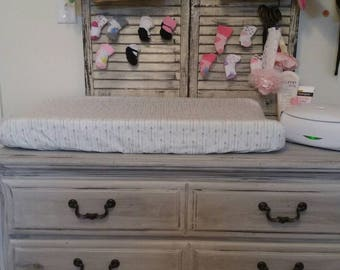 Changing table pad cover, white with blue and grey arrows