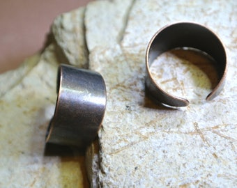 Two blank media adjustable rings, coppery tone, with a width of 1.2 cm, thickness 0, 8 mm, adjustable size 17.5
