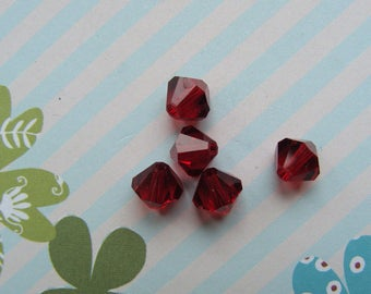 Lot 5 vermilion Crystal 6mm Swarovski bicones