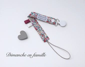 Pacifier in fabric, with snap and metal type strap buckle