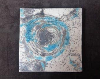 Turquoise and white Raku trivet