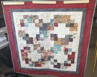Quilt, wall hanging or table topper.