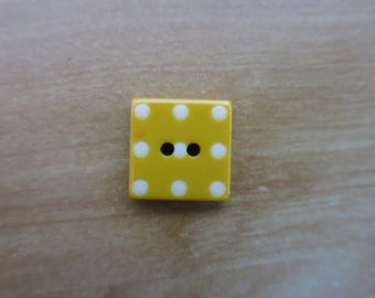 Yellow square button with white dots