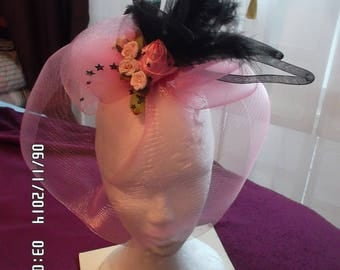 Headdress with pink veil and black feathers