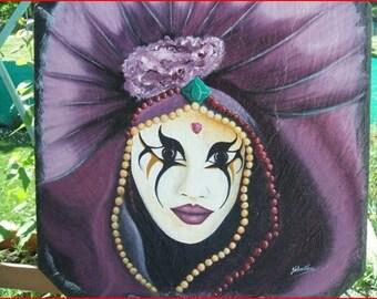 'Venetian mask' on a slate Italy