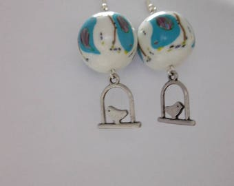 Earrings with caged birds