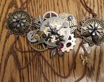Steampunk necklace with gears and clock pieces