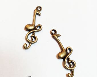 Charm bronze treble clef music note