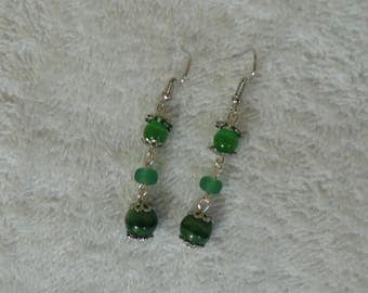 single earring with pendant and green beads