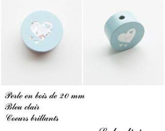 Wooden bead of 20 mm, flat Pearl light blue: Silver heart