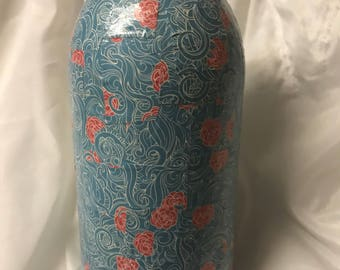 Blue jar with red flowers.