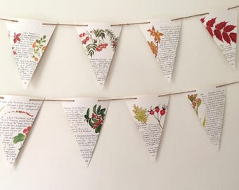 Fall botanical garland with handwritten text on rustic twine. Autumn bunting from vintage book illustrations. Housewarming gift for home